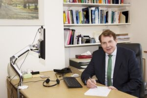 Dr Patrick Magovern at a desk